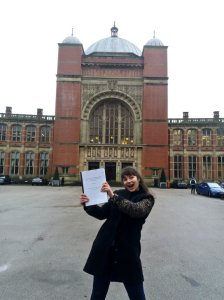 Mélina with her soft-bound thesis outside the Aston Webb Buiding